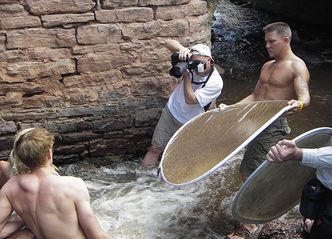Brody Hall photographing two models in Colorado stream