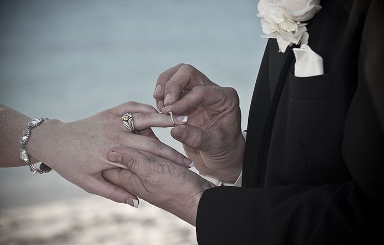Ring ceremony on a beach in the Bahamas