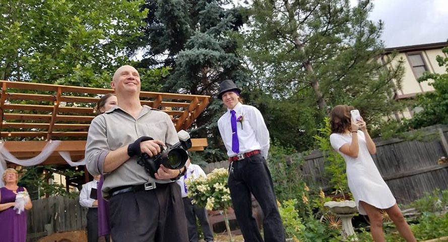 Brody Hall photographing a wedding in Denver, CO