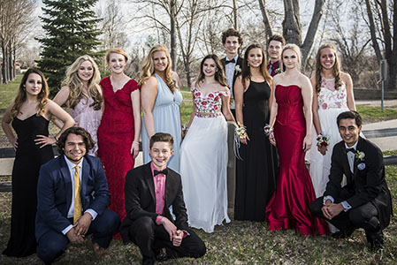High school prom photo of group of 13 males and females, outside in Parker, CO