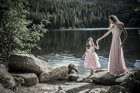 Mom and daughter dressed in pink by Bear lake in Rocky Mountain National Park