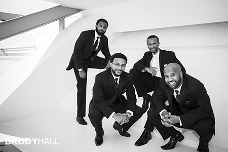 Groom and groomsmen posed at the Westin Hotel