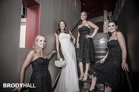 Bride and brides maids on the stairs.