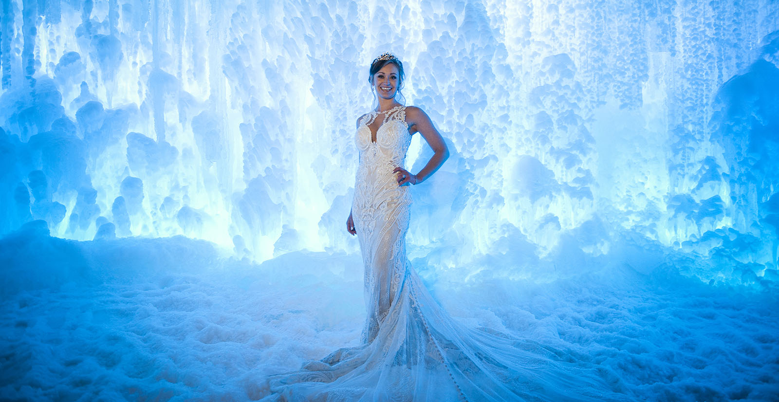 Beautiful bride in wedding gown in the Ice Castles at night, in Dillon, CO