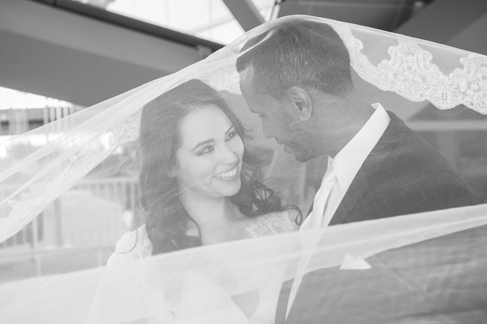 Bride and groom beneath the veil at the Westin Hotel at the Denver International Airport