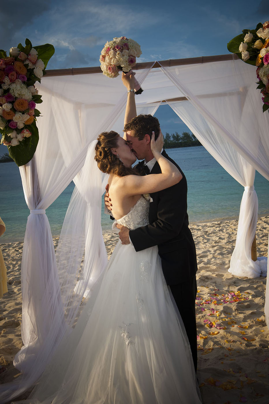 Bridal couple kissing on beach in the Bahamas