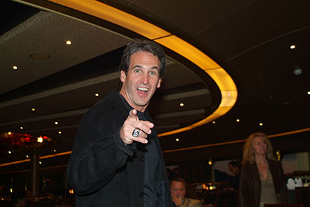 Adult male smiling and pointing at the camera, attending a corporate event on a Holland America Alaskan cruise.