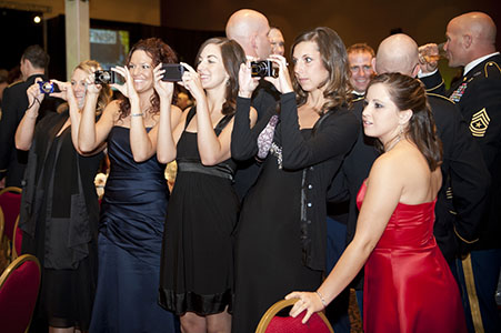 Adult women taking pictures at a corporate gala in Las Vegas, NV