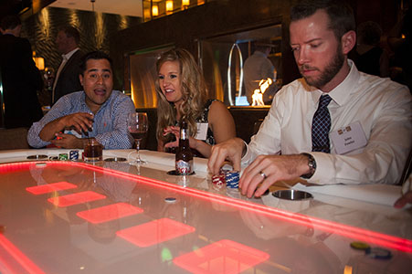 People playing blackjack at Traveler's Haven annual Christmas party, downtown Denver