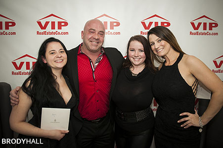 Four adults at the Grand opening event for VIP Real Estate if Cherry Creek, CO
