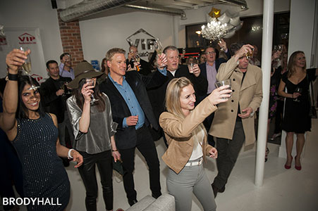 Guest raising glasses at a VIP Real Estate company party