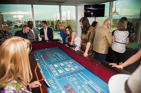 Guest playing roulette at a office party in Denver, CO