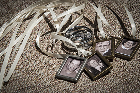 Wedding rings and small framed photos on ribbon, at Wild Basin Lodge and Event Center, Allenspark, CO