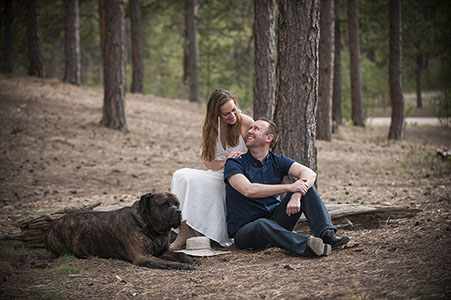 Engaged couple with their dog in the woods, Tennessee