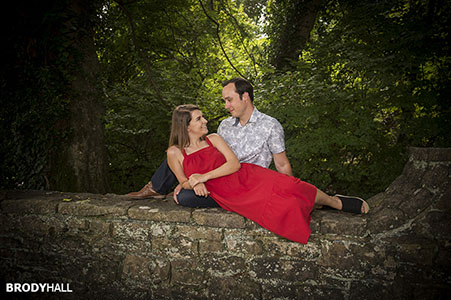 Engaged couple looking at each other at Percy Warner Park in Brentwood, Tennessee