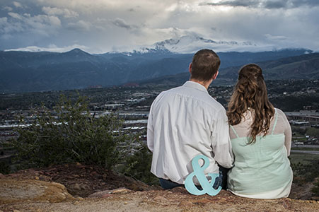 The backs of an engaged couple at Pulpit Rock, Colorado Springs, CO