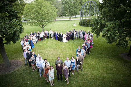 Wedding guest forming a heart at Chicago wedding venue