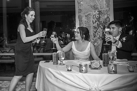 Twin sister toasting the bride and groom at the Garden of the Gods resort and club.