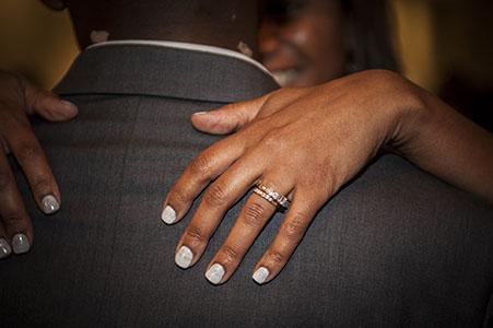 Bridal couple dancing, showing Bride's wedding ring.
