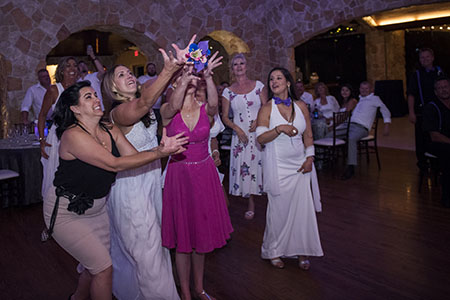 Single ladies catching the bouquet at Baldoria on the Water wedding venue