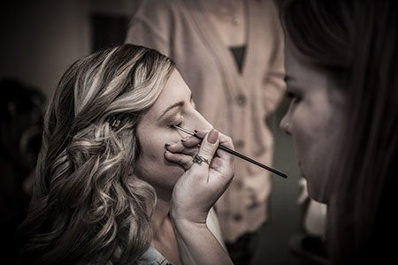 Make-up being applied to a bride