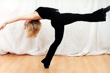 Dance School instructor performing a kick move