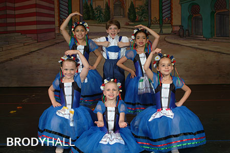 Young dance school students doing a group photo