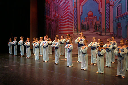 Dance school students performing an Aladdin recital