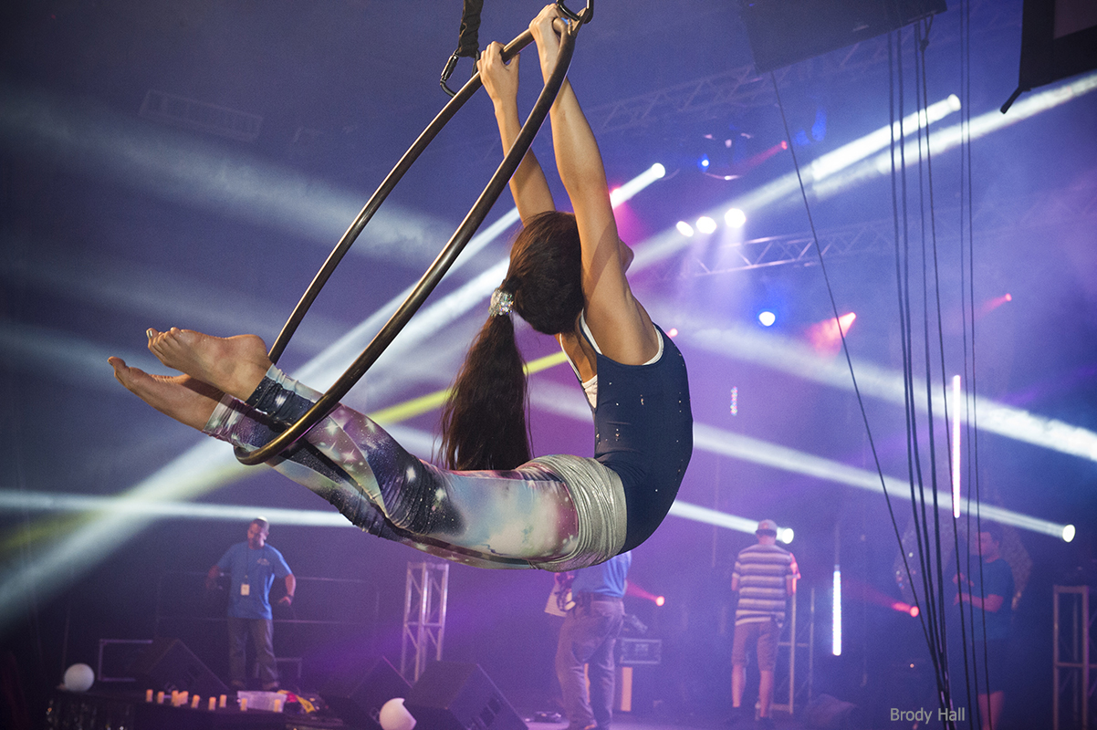 aerialist performing on the hoop at the Miracle Party