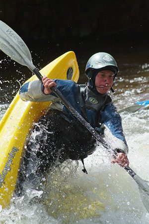 A competitor displaying his abilities at a kayak rodeo at the Teva Mountain Games in Vail, CO