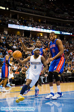 Denver Nuggets driving the lane against the Pistons.