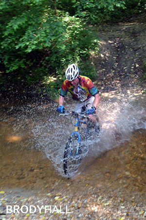Cyclist going through a stream at the Shenandoah 100 bike race