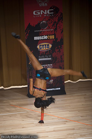 Fitness competitor showing her skills at a NPC completition