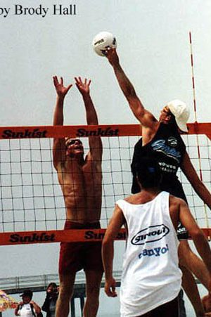 Blocking a spike at an AVP Volleyball Tournament
