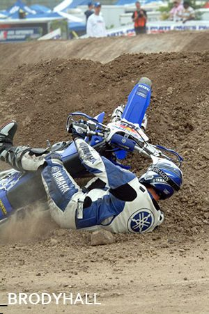 A motorcyclist biting the dust at a race