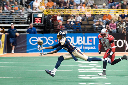 Receiver catching a ball at an Arena Football game