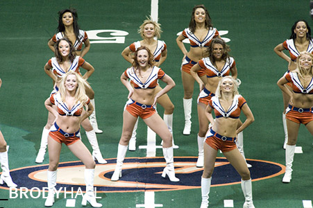 Cheer leaders performing at Arena football game