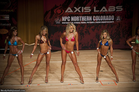 4 female competitors at the NPC Fitness competition, Golden Co
