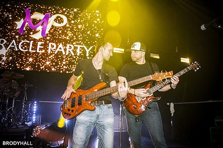 Musicians playing on stage at the Miracle Party