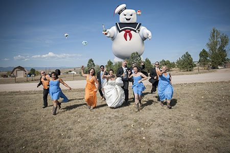 bridal party running from marshmellow man