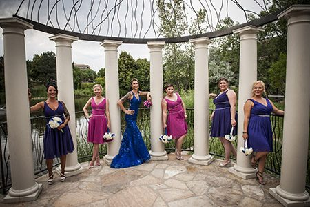 Brides maids posing in between columns