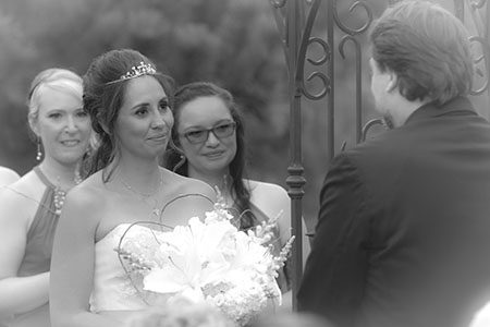Photo of the bride during the ceremony