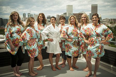 Bride and brides maids in robes - posing on rooftop