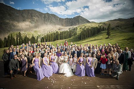 Bridal party and guest outside in the mountains