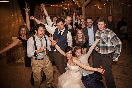 Bridal party having fun at the reception