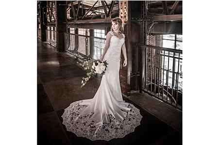 Regina in wedding gown at Mile High Sports club