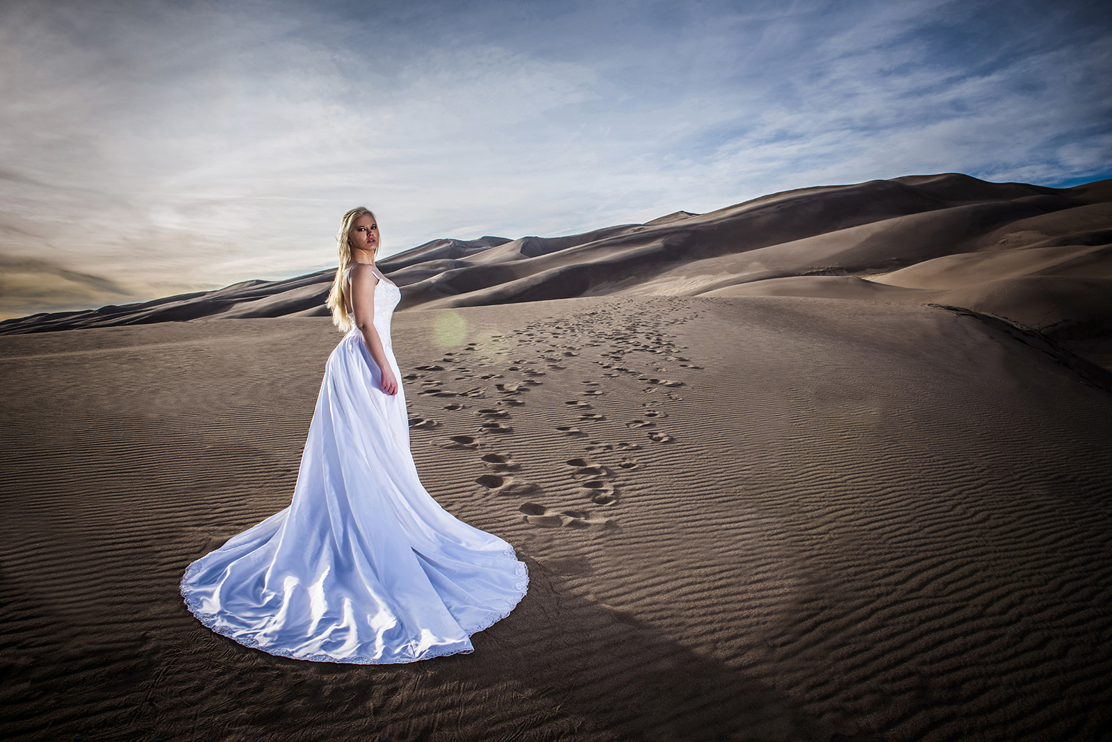 Sky in wedding dress at Great Sand Dunes