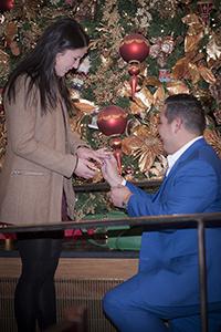 Chris putting ring on Meghan's finger