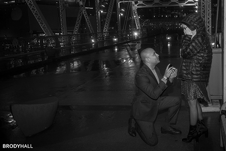 Rawood on bridge proposing to Paulina