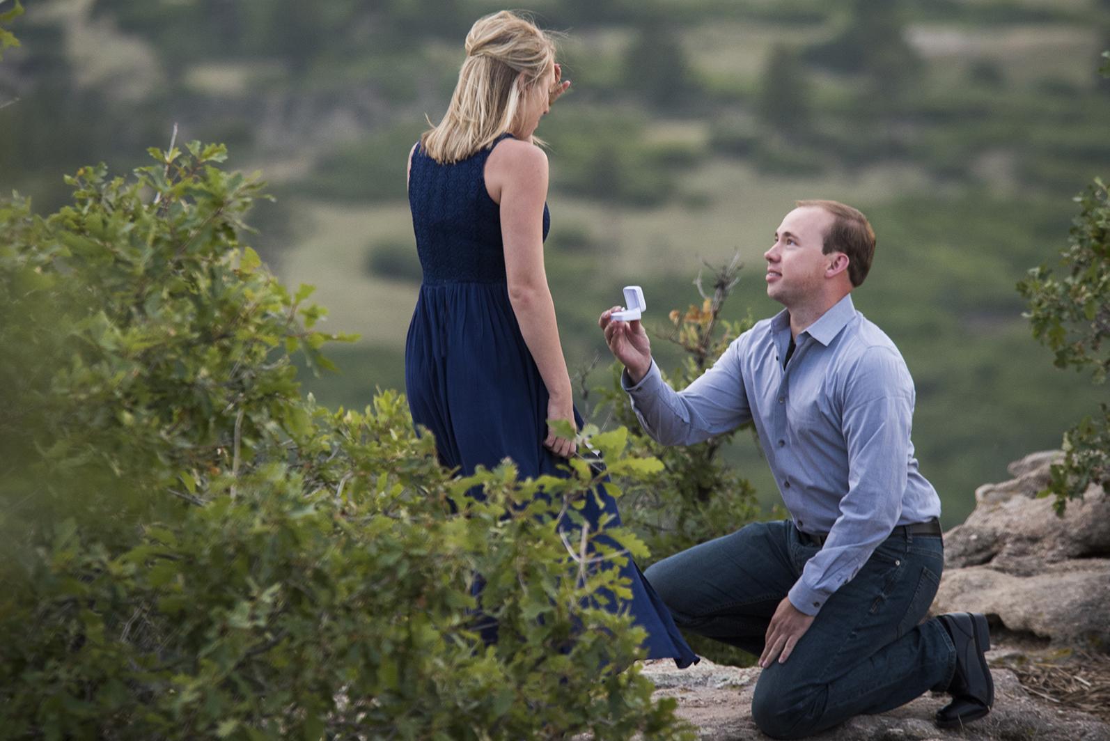 Shane kneeling, proposing to Kim.